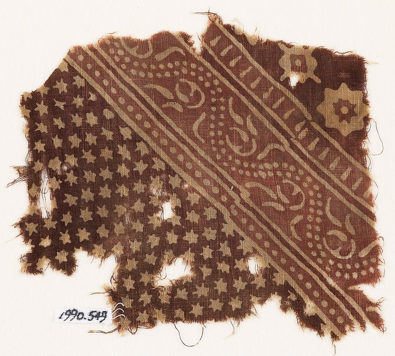 Textile fragment with small and large stars, and a dotted vine (front            )