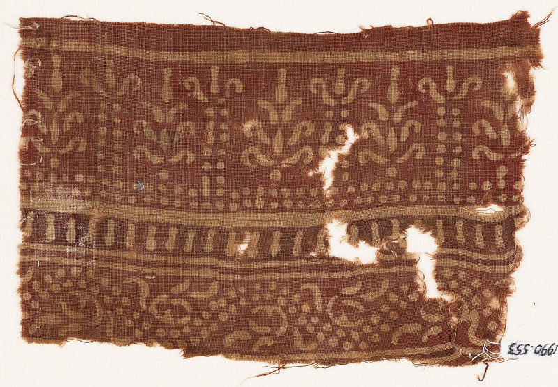 Textile fragment with bands of columns and stylized trees, and a dotted vine