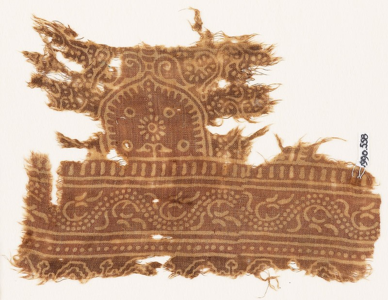 Textile fragment with arch and dotted vine