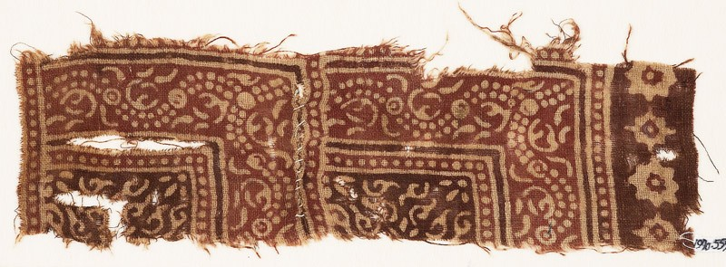Textile fragment with dotted vine and stylized tendrils