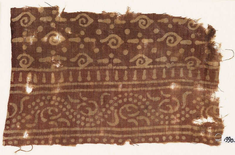 Textile fragment with spirals and dotted vine