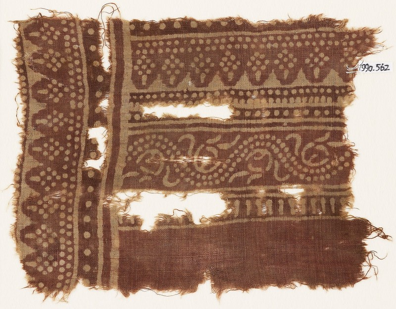 Textile fragment with dotted vine and rhombic shapes (front            )
