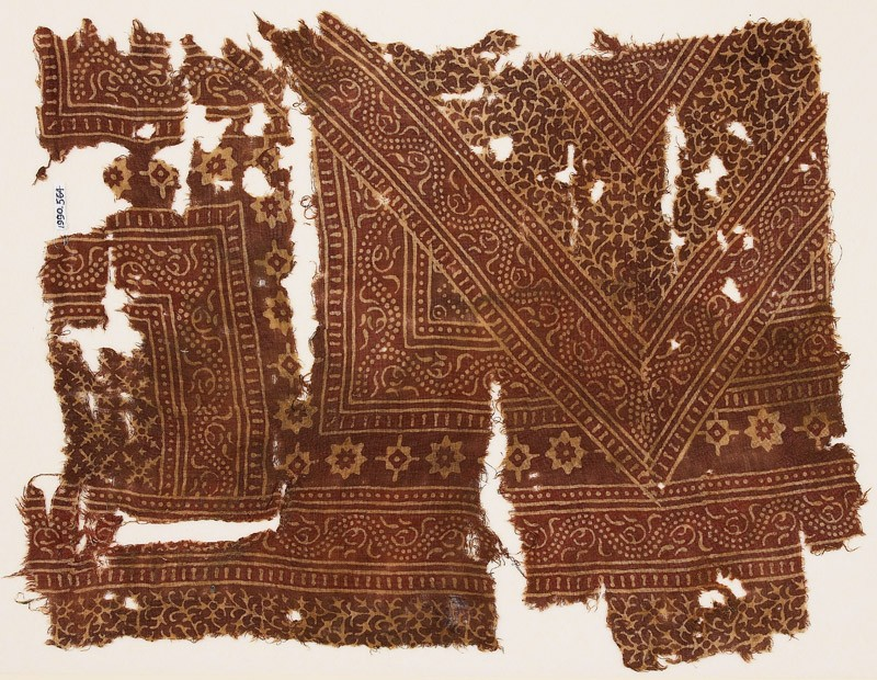 Textile fragment with bands of dotted vines, stars, and serrated crosses