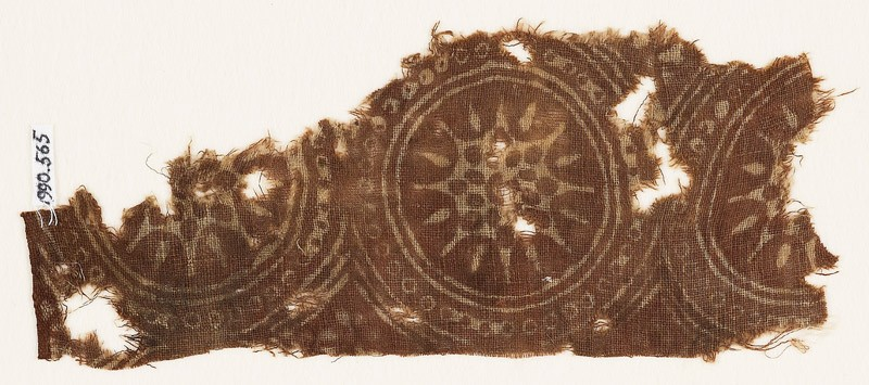 Textile fragment with star-shaped flowers in dotted circles (EA1990.565, front            )