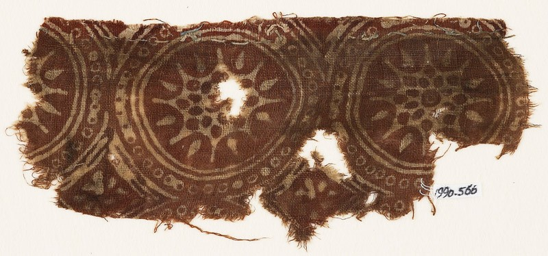 Textile fragment with star-shaped flowers in dotted circles (front            )