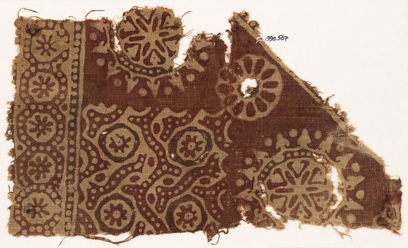 Textile fragment with rosettes in dotted circles, flower-heads, and dotted tendrils (EA1990.567, front            )