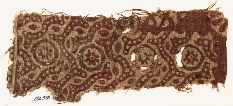 Textile fragment with dotted tendrils and small rosettes in circles (EA1990.568, front            )