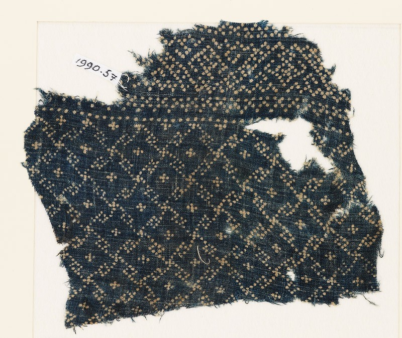 Textile fragment with rosettes and linked S-shapes made of dots (EA1990.57, front           )
