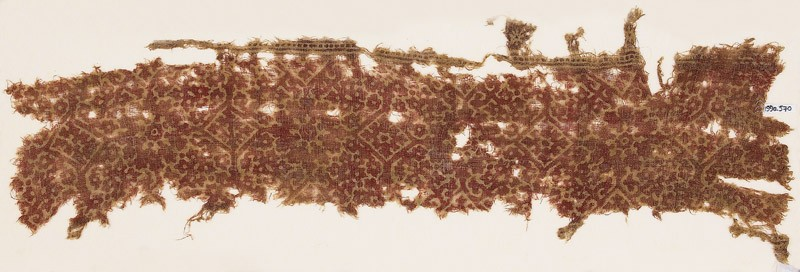 Textile fragment with ornate squares and flower-heads