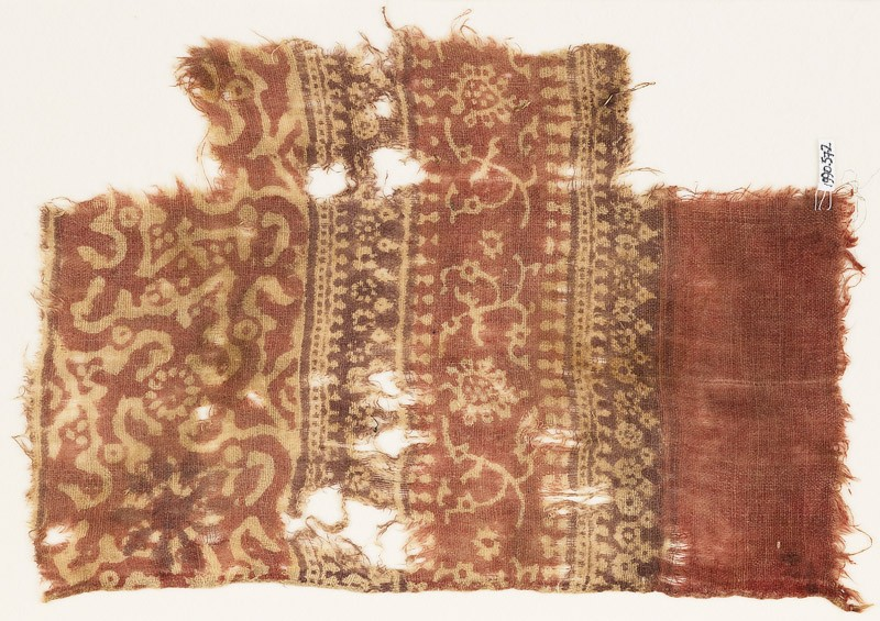 Textile fragment with tendrils, flower-heads, small flowers, and arches