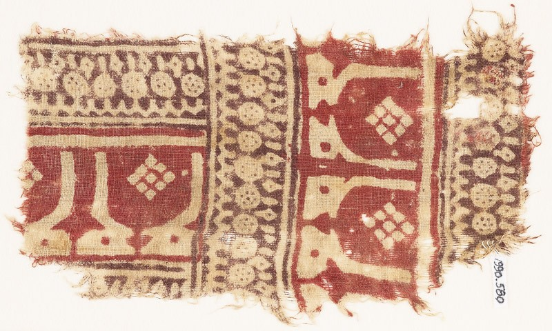 Textile fragment with arches or stupas, and arches probably based on kufic script