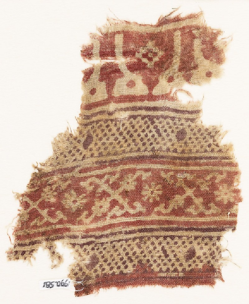 Textile fragment with bands of arches or stupas, dots, and crosses made of tendrils (EA1990.581, front            )