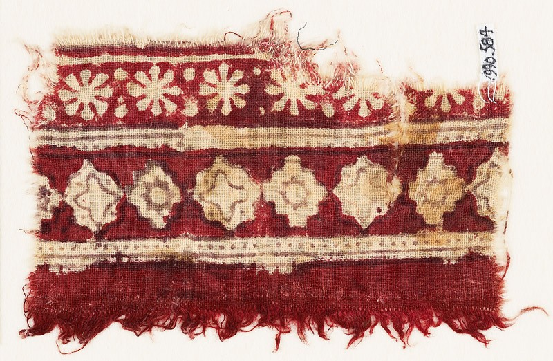Textile fragment with bands of rosettes, diamond-shapes, stepped squares, and stars (front            )