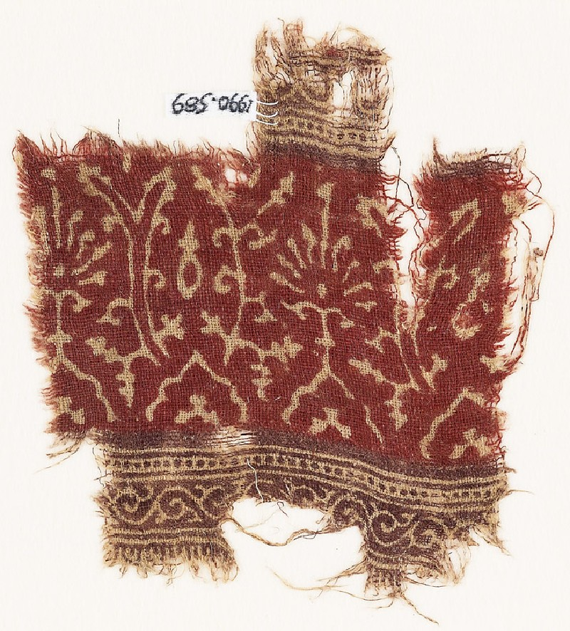Textile fragment with stylized plants and vines