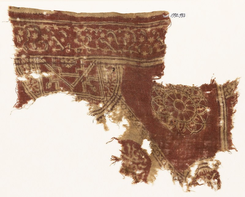 Textile fragment with semicircle, complex rosette, and circle fragment with script (EA1990.597, front            )