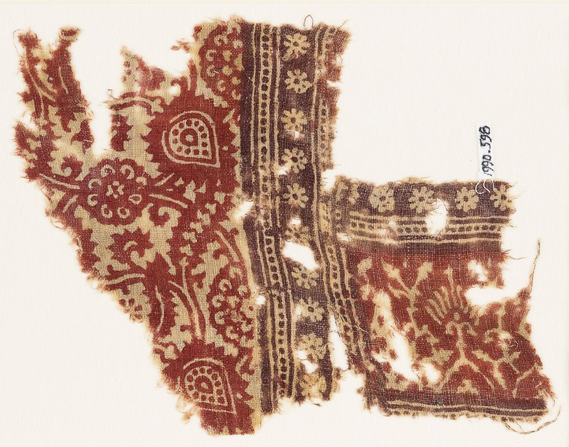 Textile fragment with elaborate flowers, tendrils, rosettes, and stylized plants