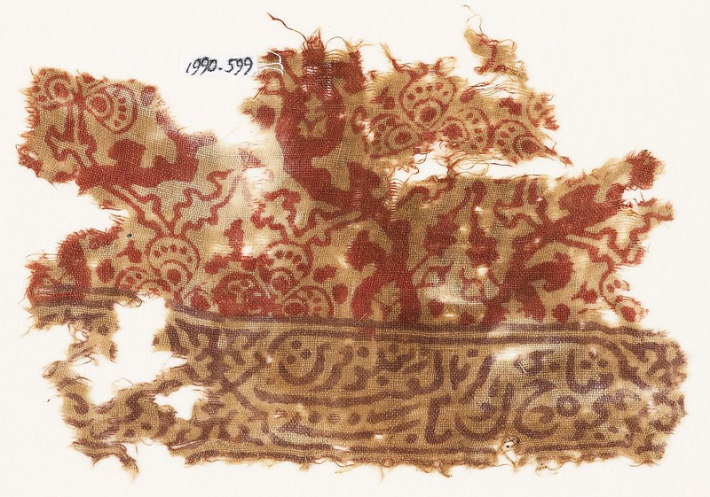 Textile fragment with Persian script and floral shapes