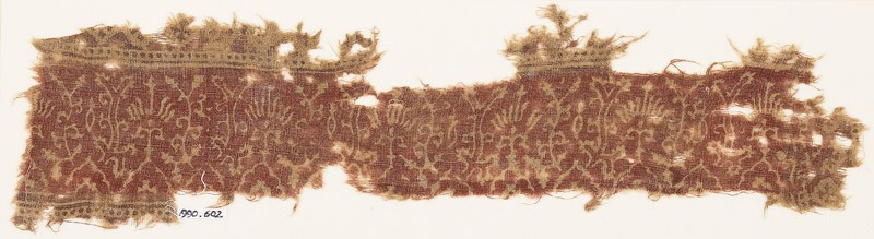 Textile fragment with plants and flowers