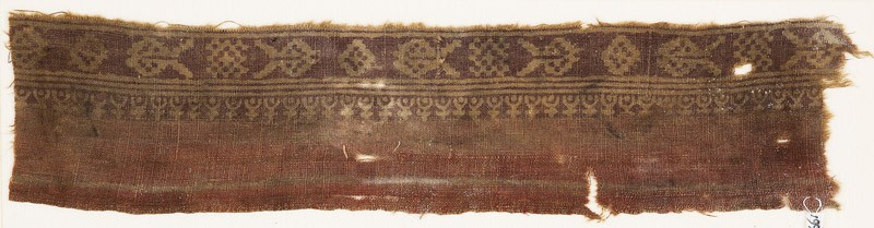 Textile fragment imitating patola pattern, with diamond-shapes, squares, and hearts