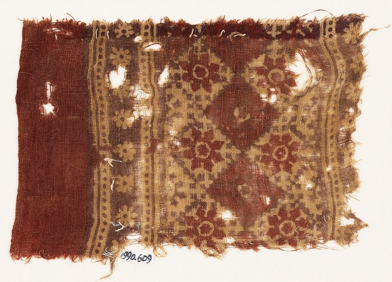 Textile fragment with grid of squares and rosettes (EA1990.609, front            )
