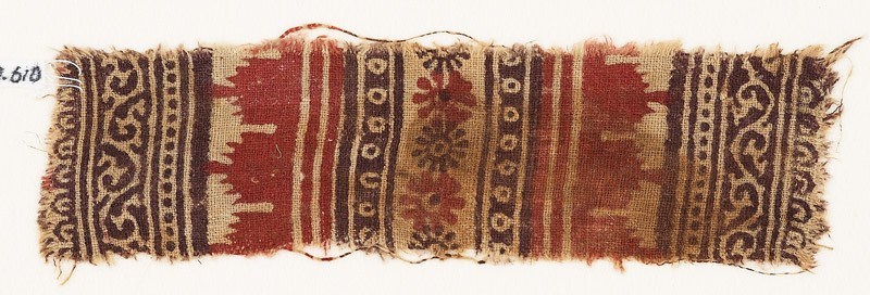 Textile fragment with bands of vines and tendrils, crenellations, rosettes, and dots (front            )