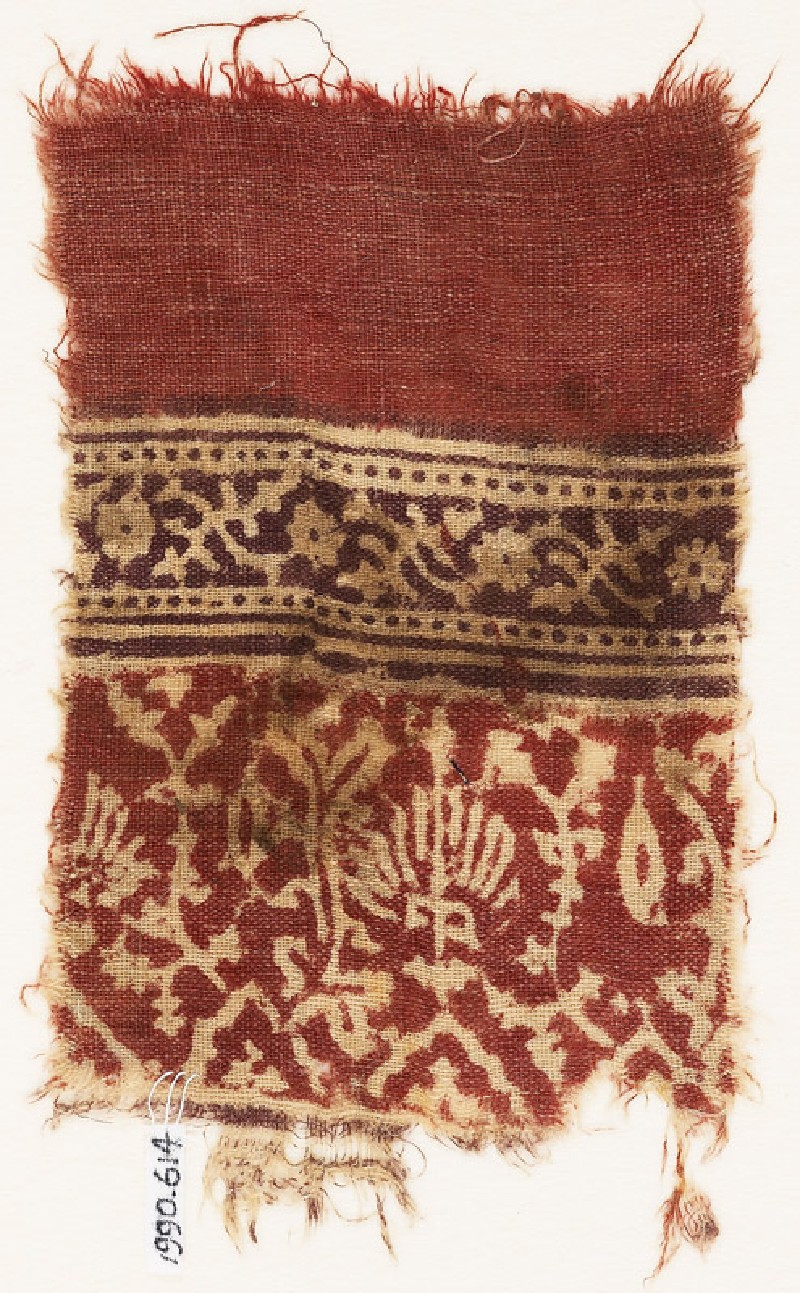 Textile fragment with stylized plants, half-medallions, and crossed tendrils