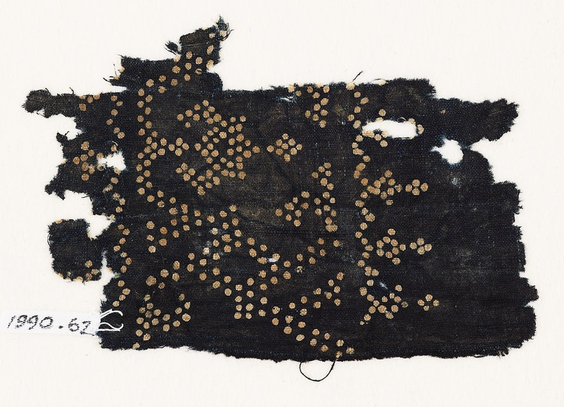 Textile fragment with dots arranged as a band, possibly with a vase shape (EA1990.62, front           )