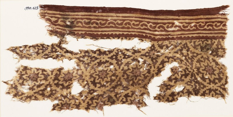 Textile fragment with tendrils arranged as medallions, rosettes, and a vine