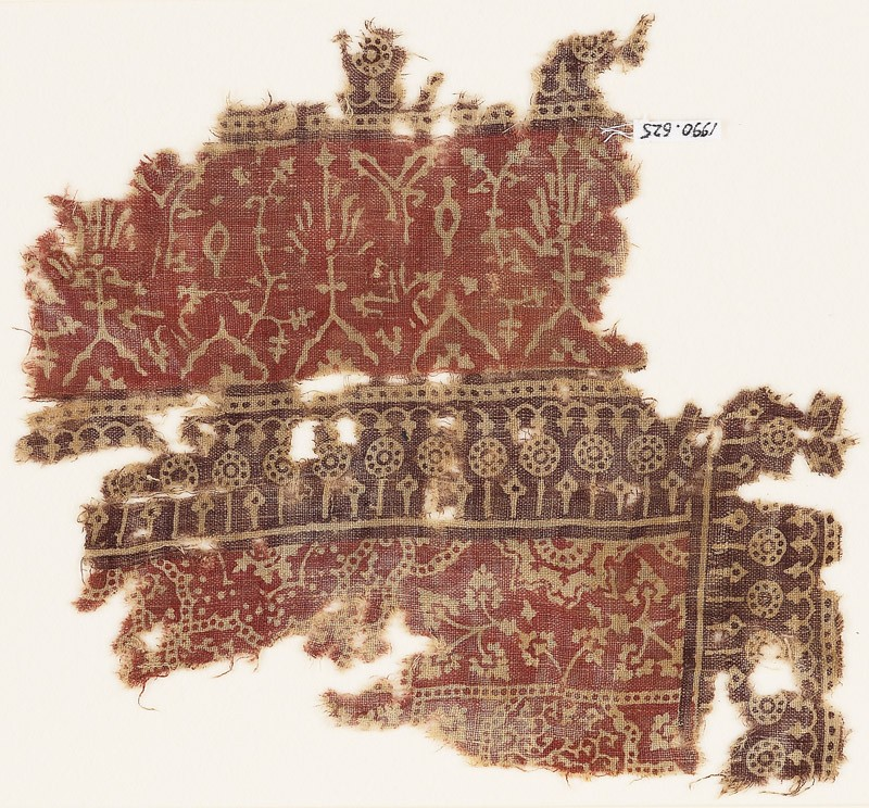Textile fragment with plants, half-medallions, and dotted circles