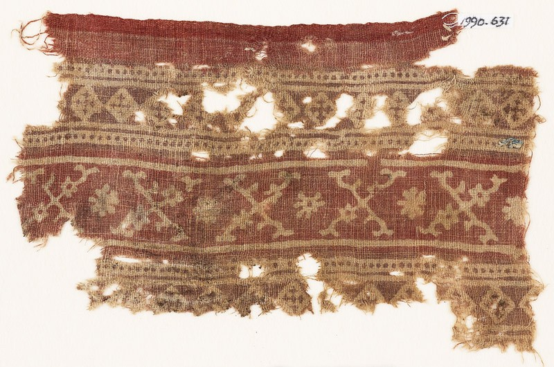 Textile fragment with bands of crossed tendrils, rosettes, and linked squares (EA1990.631, front            )