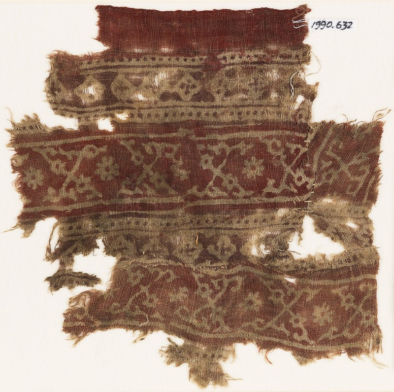 Textile fragment with bands of crossed tendrils, rosettes, and linked squares (EA1990.632, front            )