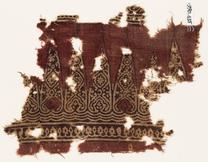 Textile fragment with cone-shapes and ornate floral designs