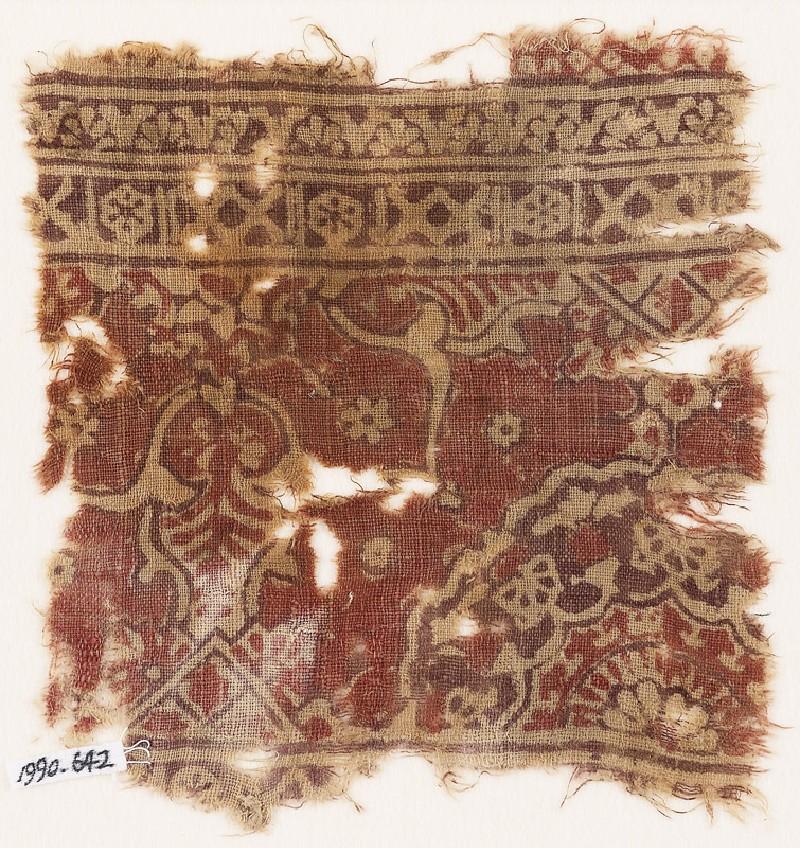 Textile fragment with ornate floral design and a large half-medallion (front            )