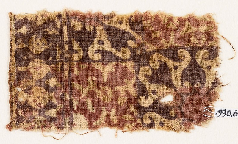 Textile fragment with squares, spirals, and possibly tendrils (front            )