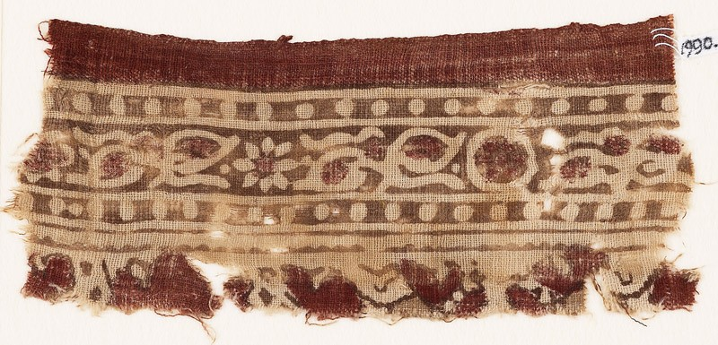 Textile fragment with bands of rosettes, leaves, and dots