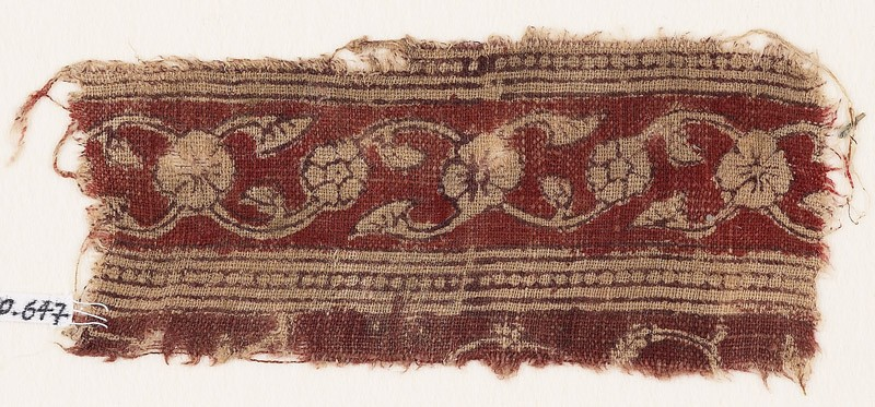 Textile fragment with vine, flowers, leaves, and lotus blossoms