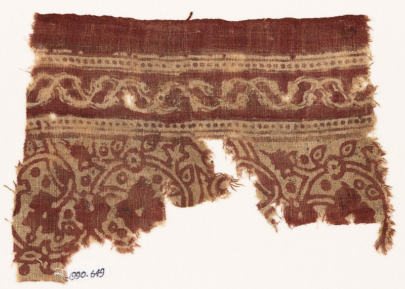 Textile fragment with flower-heads, rosettes, and interlacing vines (EA1990.649, front            )