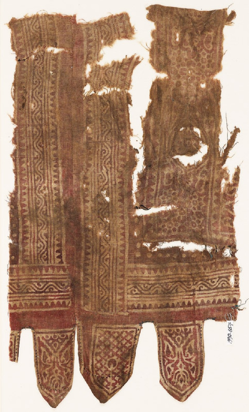 Textile fragment with medallions, linked rosettes, vines, and tabs (front            )