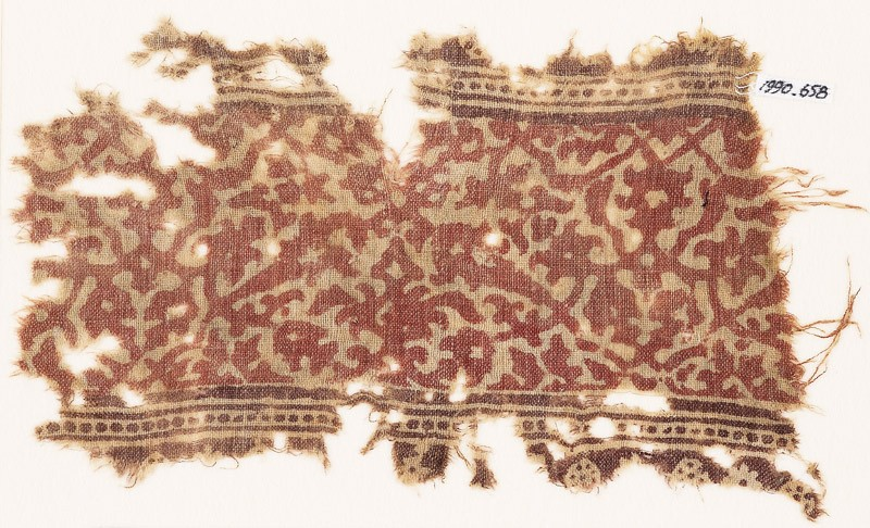 Textile fragment with interlacing vines, leaves, and flower-heads (front            )
