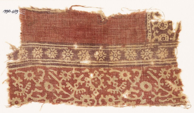 Textile fragment with stylized plants, crossed tendrils, and flowers