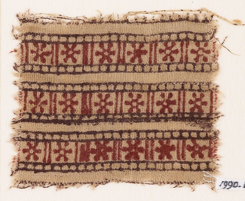 Textile fragment with bands of rosettes and lines (EA1990.668, front            )