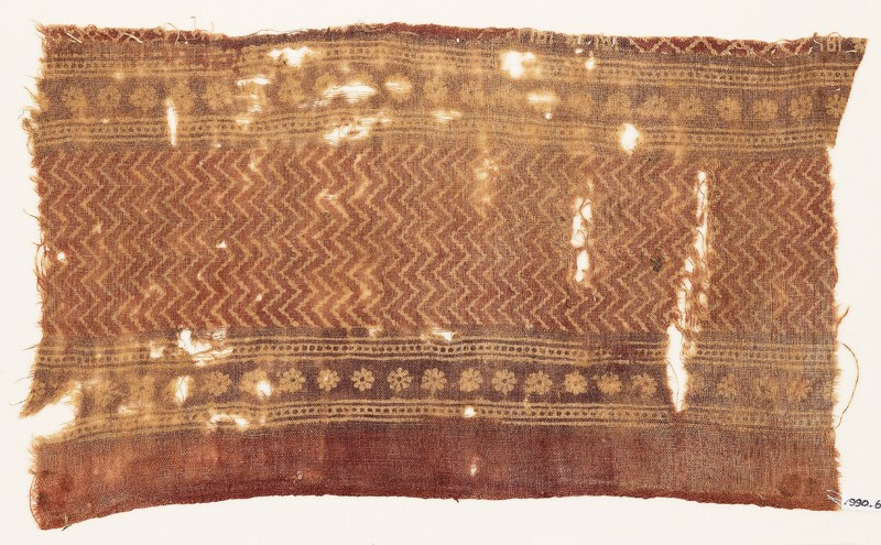 Textile fragment with chevrons and rosettes