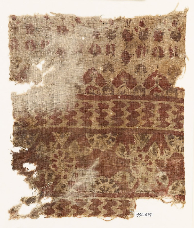 Textile fragment with rosettes, chevrons, and possibly floral designs