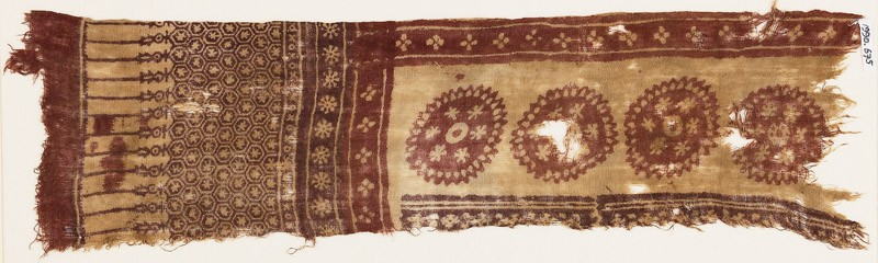 Textile fragment with large circles, flowers, and hexagons (front            )