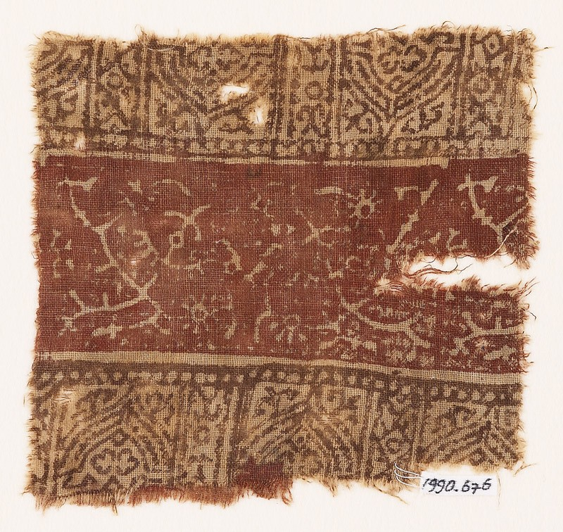 Textile fragment with crossed tendrils, flowers, and arches