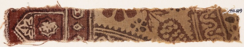 Textile fragment with floral design, small cartouches, and a tab-shape (EA1990.679, front            )