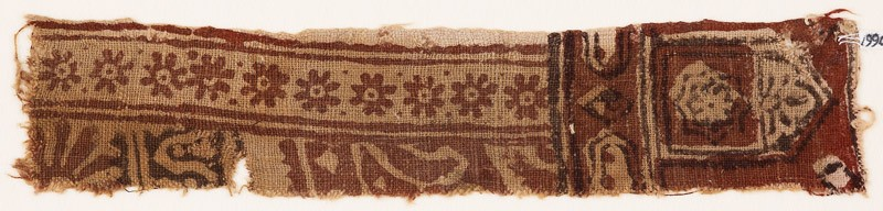 Textile fragment with rosettes, small cartouches, and a tab-shape (EA1990.680, front            )