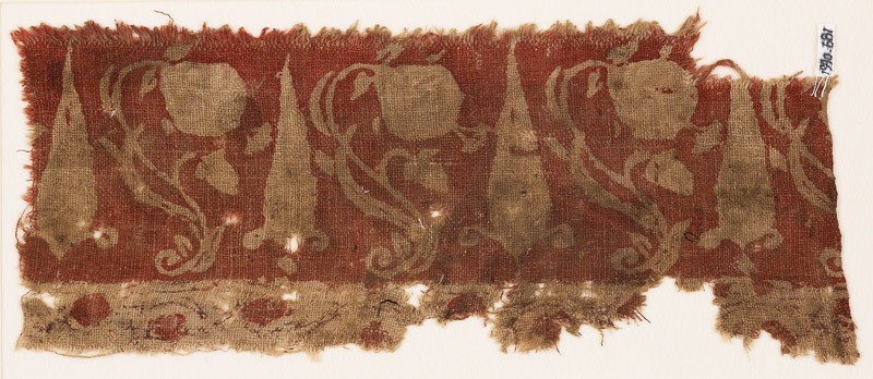 Textile fragment with large flowers, undulating stems, and possibly stylized leaves (EA1990.681, front            )