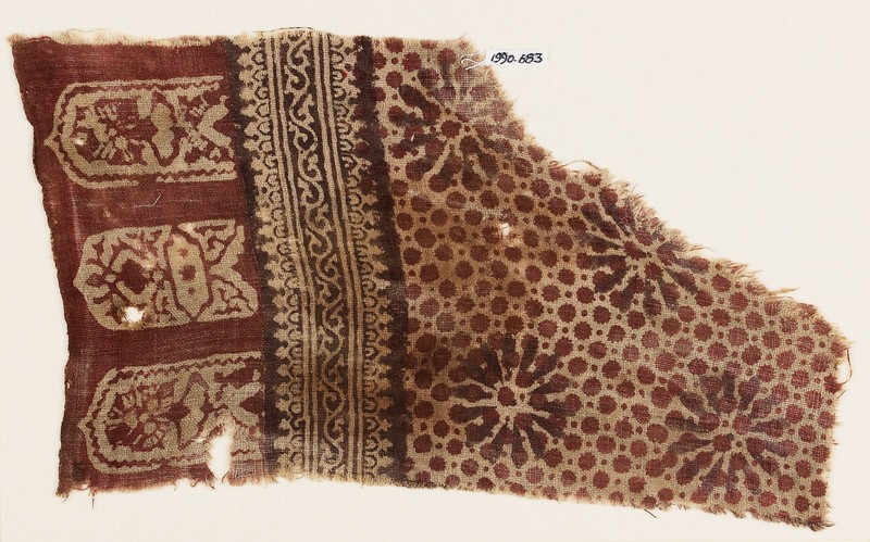 Textile fragment with rosettes, dots, and tab-shapes (EA1990.683, front            )