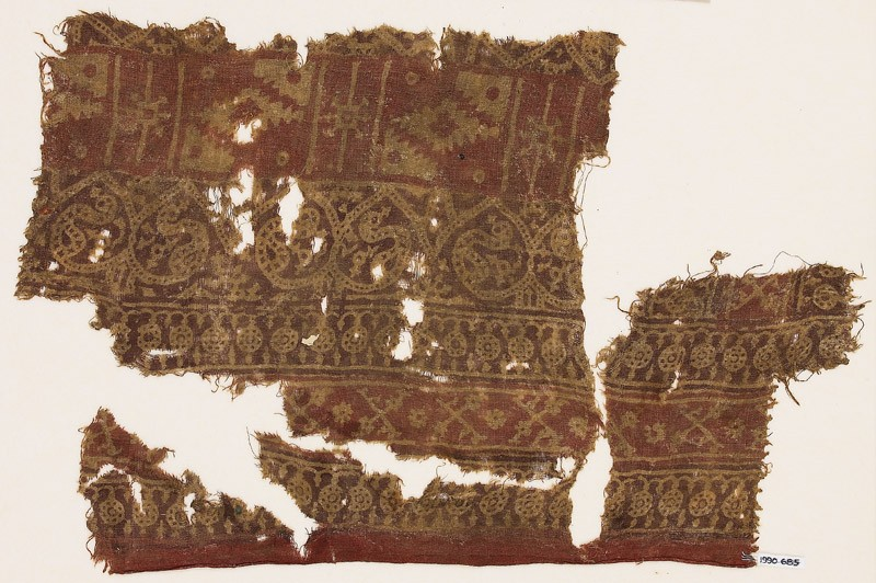 Textile fragment with circles, crossed tendrils, dotted tendrils, and stepped diamond-shapes